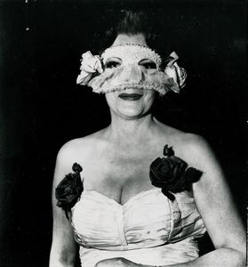 DIANE ARBUS - Lady at a masked ball with two roses in her dress,  NYC