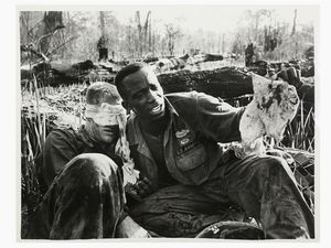Steve Northup - Army medic helping wounded soldier Chu Pong Vietnam 1969